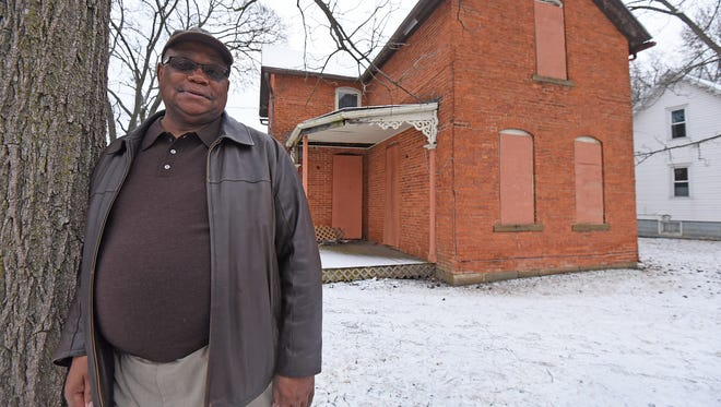 Mansfield UMADAOP executive director Dennis Baker poses for a photo outside 89 Wood St. UMADAOP is converting the house, the first African-American-owned home in Richland County, into an African-American history museum.