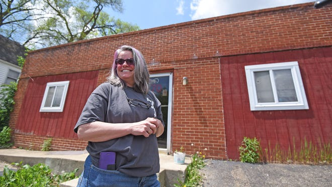 Angie Henke is excited about the new home of the Reaching Out Mission at 70 Hedges Street.