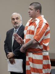 John Paul Perry stands with his attorney, Joe Spencer,