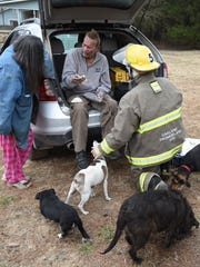 Emergency personnel help Perry Boore on Feb. 4, after he was seriously burned trying to save dogs from his burning home. Boore is in a Little Rock hospital fighting pneumonia.