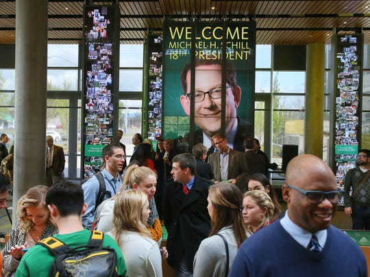Students, faculty and administrators gather inside the Ford Alumni Center beneath a photograph of Michael Schill, moments after a press conference introducing Shill as the 18th president of the University of Oregon in Eugene, Tuesday, April 14, 2015. Schill is formerly dean of the University of Chicago Law School.