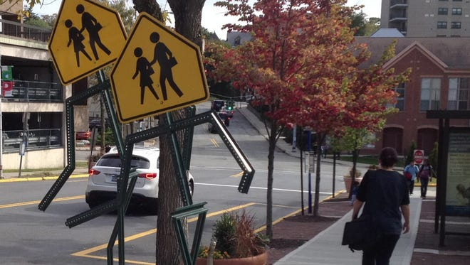 Public art at a crosswalk in Peekskill reminds motorists to stop for pedestrians. Peekskill was one of several Westchester County communities the AAA recognized recently for pedestrian and traffic safety.