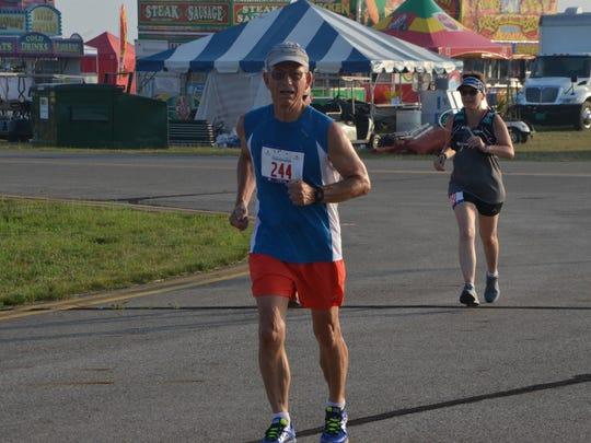 Linn Kracht, 70, runs at the W.K. Kellogg Airport during the Battle Creek Half Marathon on Saturday, June 30, 2018.