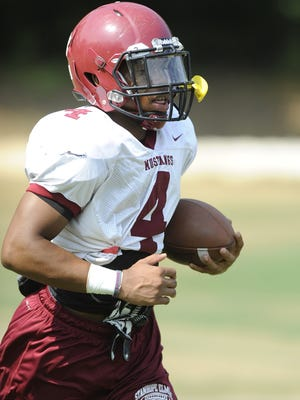 Running back BJ Smith carries the ball during football practice at Stanhope Elmore High School in Millbrook, Ala. on Thursday August 7, 2014.