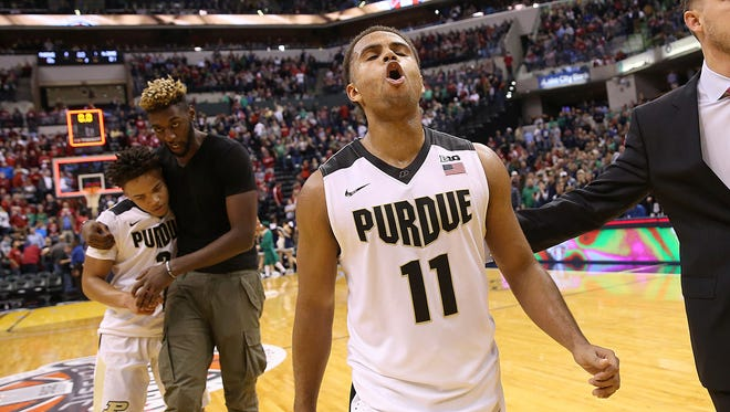 Purdue Boilermakers guard P.J. Thompson (11) celebrates the team's victory over the Notre Dame Fighting Irish in the Crossroads Classic at Bankers Life Fieldhouse in Indianapolis, Saturday, Dec. 17, 2016.