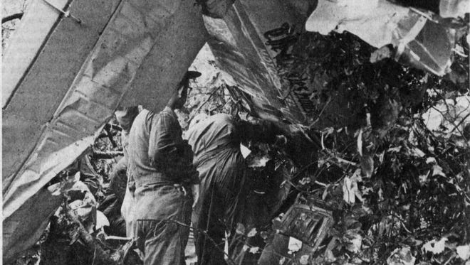 Investigators at the Sept. 14, 1973 airplane crash on Elliot's Knob.