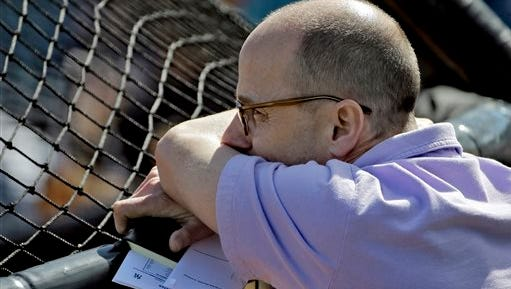 New York Yankees general manager Brian Cashman watches live batting practice during a spring training baseball workout Monday, Feb. 22, 2016, in Tampa, Fla.