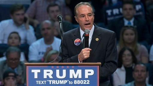 Rep. Chris Collins, R-N.Y., speaks to the crowd before the arrival of Republican presidential candidate Donald Trump during a campaign stop at the First Niagara Center, Monday, April 18, 2016, in Buffalo, N.Y.