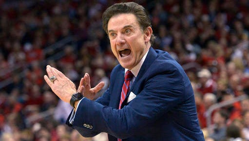 FILE - In this Feb. 17, 2016, file photo, Louisville coach Rick Pitino gestures to his team during an NCAA college basketball game against Syracuse in Louisville Ky.  Pitino's No. 10 Cardinals are the highest ranked team in the eight-team field at the Battle 4 Atlantis tournament in Paradise Island, Bahamas. (AP Photo/Timothy D. Easley, File)