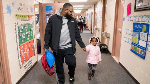 Eric Grant takes his three-year-old daughter Makayla to preschool in Philadelphia, Friday, Jan. 6, 2017. Thousands of Philadelphia toddlers are starting 2017 in a city pre-kindergarten program, launched this week alongside a new sugary beverage tax created to fund it.