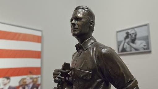 A maquette of Gerald R. Ford, left, is on display at the Gerald R. Ford Presidential Museum in Grand Rapids on Wednesday, Jan. 11, 2017. The maquette is a smaller version of a statue onboard the USS Gerald R. Ford supercarrier created by sculptor Brett Grill