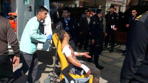A Syrian man who was wounded at a blast in Al-Bab, a town in northern Syria, is wheeled at the hospital in Kilis, southeastern Turkey, Friday, Feb. 24, 2017. A car bomb went off Friday north of the town, that was controlled by Islamic State militants since late 2013 and was just captured by Turkish forces and Syrian opposition fighters, killing dozens of people, mostly civilians who gathered seeking to return to their liberated area, Turkey's news agency and Syrian opposition said.