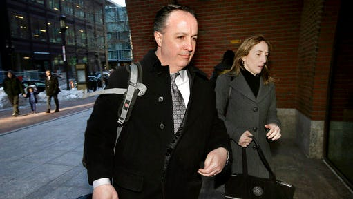 Barry Cadden, center, arrives at the federal courthouse, Thursday, March 16, 2017, in Boston, before scheduled closing arguments in his trial. Cadden, a former pharmacy executive and the president of New England Compounding Center, is charged with causing the deaths in 2012 of 25 people who received tainted steroids manufactured by the pharmacy.