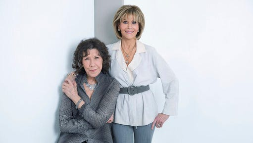 """In this March 24, 2017 photo, Lily Tomlin, left, and Jane Fonda, co-stars in """"Grace and Frankie,"""" pose for a portrait in New York. The third season of the comedy series is currently streaming on Netflix."""