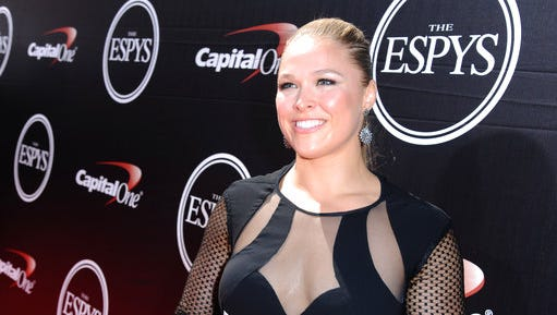 FILE - In this  July 15, 2015, file photo, Ronda Rousey arrives at the ESPY Awards at the Microsoft Theater in Los Angeles. Rousey announced her engagement to fellow MMA fighter Travis Browne on April 20, 2017.