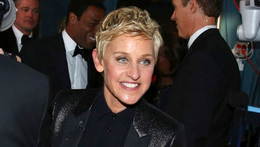 FILE - In this March 2, 2014 file photo, Ellen DeGeneres appears backstage during the Oscars in Los Angeles. DeGeneres made history 20 years ago as the first prime-time lead on network TV to come out, capturing the hearts of supporters gay and straight amid a swirl of hate mail, death threats and, ultimately, dark times on and off the screen.