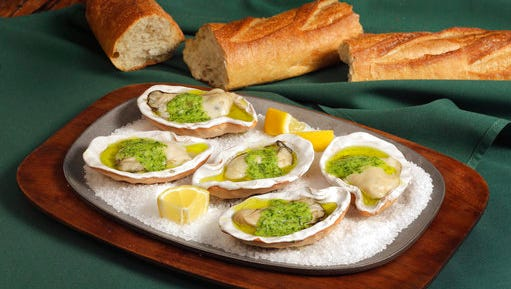 This April 3, 2017 photo shows grilled oysters, at the Institute of Culinary Education in New York. This dish is from a recipe by Elizabeth Karmel.