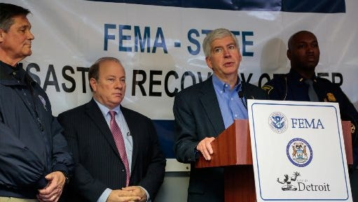 Governor Rick Snyder speaks to the press at the FEMA- State Disaster Recovery Center on Monday November 17, 2014 in the Academic Administration Building of the Wayne Community College District Northwest campus while addressing the extension of the deadline for FEMA's SBA loans to those affected in the August 11, 2014 floods that damaged homes throughout metro Detroit.