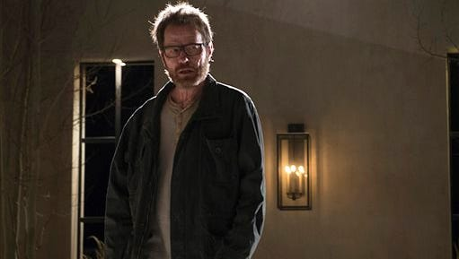 """In this undated file image released by AMC shows Bryan Cranston as Walter White in a scene from the series finale of """"Breaking Bad"""".  Toys R Us is pulling its four collectible dolls based on characters from AMC's hit series """"Breaking Bad"""" after taking heat from a Florida mom who launched a petition campaign. The dolls are based on the series about Walter White, a high school chemistry teacher who turns into a crystal meth dealer, and his sidekick Jesse Pinkman. The figures have a detachable bag of cash and a bag of methamphetamines. Toys R Us, which is based in Wayne, New Jersey, told The Associated Press late Tuesday that the dolls are being removed immediately from its website and shelves."""
