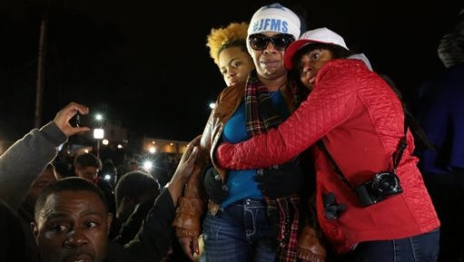 Lesley McSpadden, Michael Brown's mother, is comforted outside the Ferguson police department as St. Louis County Prosecutor Robert McCulloch conveys the grand jury's decision not to indict Ferguson police officer Darren Wilson in the shooting death of her son, Monday, Nov. 24, 2014 in Ferguson, Mo.
