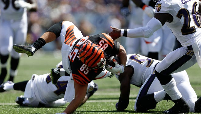 Bengals tight end Tyler Eifert hits the ground and injured his elbow on this play against the Baltimore Ravens in Baltimore on Sunday.