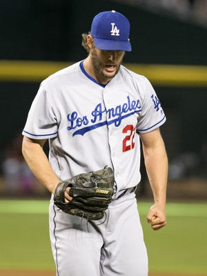 Dodgers pitcher Clayton Kershaw reacts after retiring the side in the seventh inning of the MLB game against the Diamondbacks at Chase Field in Phoenix on Wednesday, June 15, 2016.