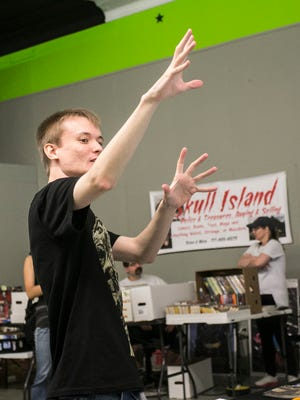 Walking Dead actor Jeremy Ambler, gestures while talking to co-star Don Teems during an appearance at Timeline Arcade Saturday, May 14, 2016. Amanda J. Cain photo
