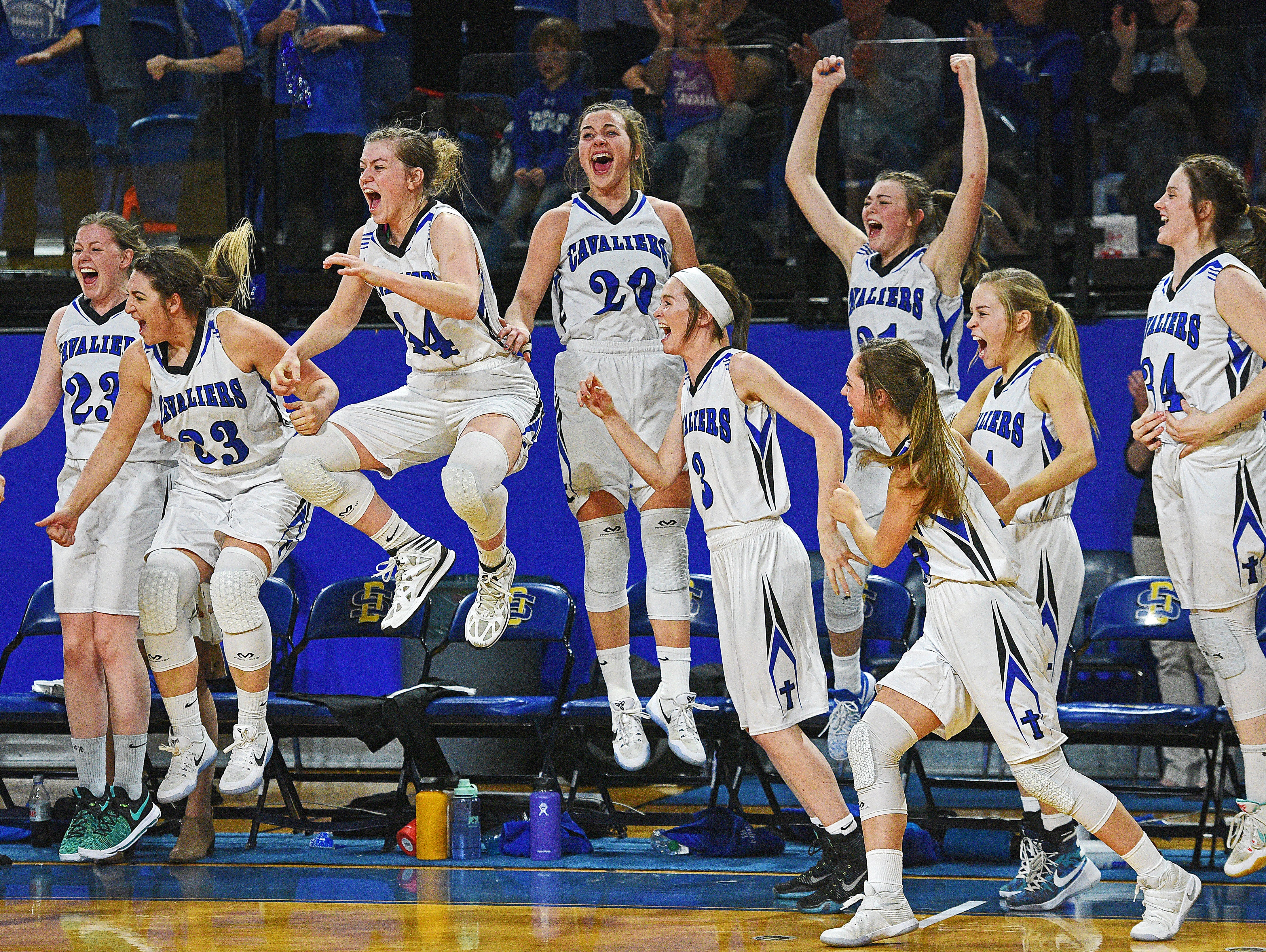 St. Thomas More players celebrate their 47-36 win over Lennox in the 2017 SDHSAA Class A State Girls Basketball Tournament championship game Saturday, March 11, 2017, at Frost Arena on the South Dakota State University campus in Brookings, S.D.