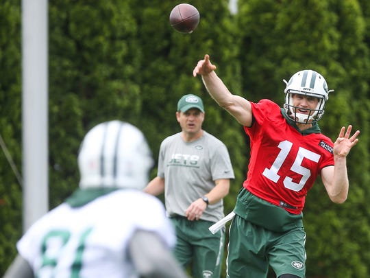Jets quarterback Josh McCown (15) throws a pass during organized team activities at the Atlantic Health Jets Training Center.