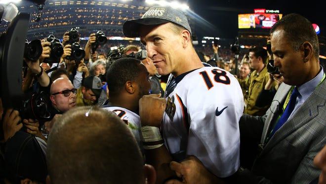 Peyton Manning walks off the sidelines after the Denver's 24-10 win over Carolina in Super Bowl 50.