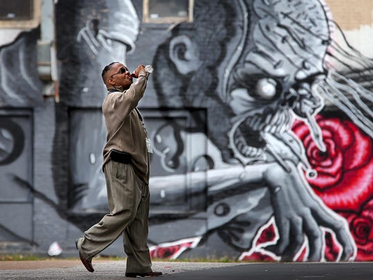 Gary Williams heads to the corner convenience store across the street from a creepy mural near the intersection of Willett and Lamar. A few of the murals lining the nearby street, which are part of Paint Memphis' annual street and graffiti art project, are generating controversy and withering reviews from City Council members.