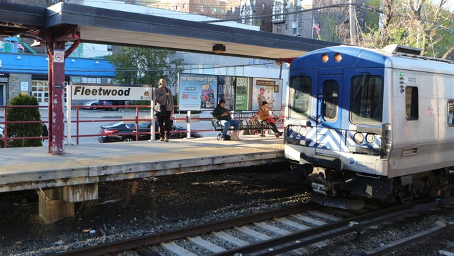 Northbound commuters catch the Metro-North train from the Fleetwood train station in Mount Vernon.
