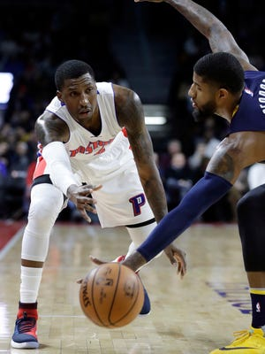 Pistons guard Kentavious Caldwell-Pope (5) passes the ball around Pacers forward Paul George (13) during the first half Saturday at the Palace.