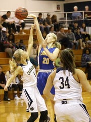 Notre Dame's Courteney Crater blocks a shot from Lansing's