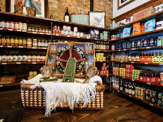 Shelves are adorned with homemade pastas, marina sauces,