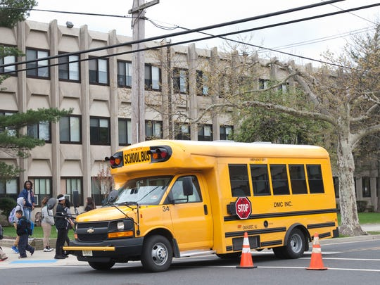 Students at the Asbury Park Middle School leave the building at the end of classes Thursday.