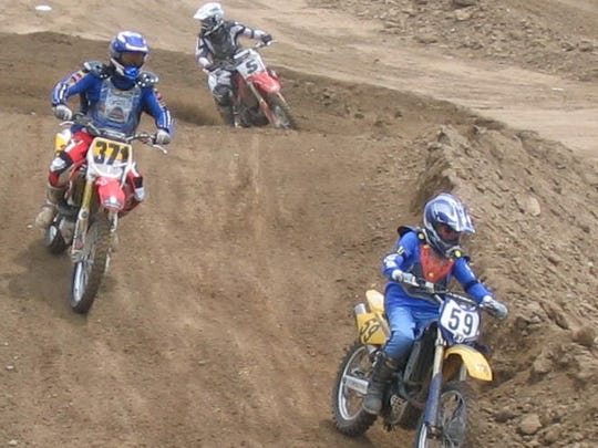 Dave Scott of Monmouth (59) leads the pack  through a turn at the Prairie City OHV Park in Rancho Cordova.