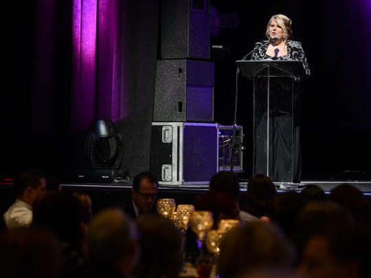 Pam Nash, executive director of the Exchange Club-Carl Perkins Center for the Prevention of Child Abuse, speaks at the Blue Suede dinner and auction Saturday in 2016.