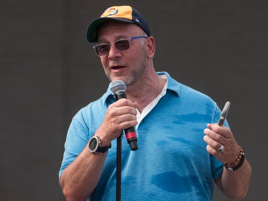 Montgomery Biscuits' owner Lou DiBella speaks at the team's Block Party in front of Riverwalk Stadium in Montgomery, Ala. on Saturday June 24, 2017.