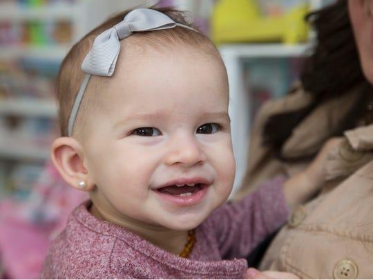 Ella Jones, 1, the daughter of Laura Sarantinoudis-Jones,