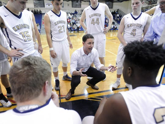 Pittsford Sutherland head coach John Nally talks to his team during a timeout during a regular season game played at Pittsford Sutherland High School, Friday, Dec.15, 2017. Pittsford Sutherland beat Greece Athena 52-43.