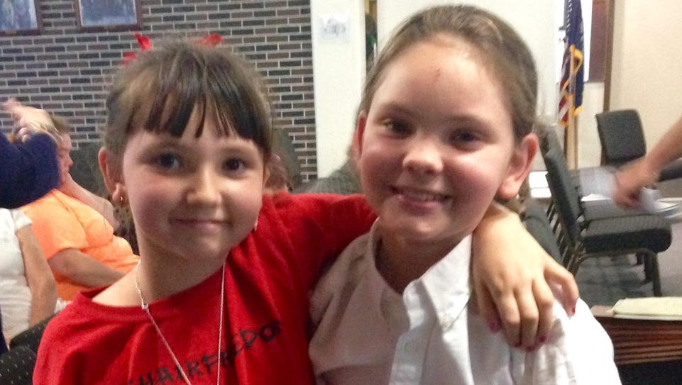 Morgan Bodiford (left) supports her brother Ashton