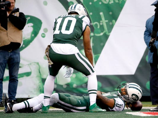 14365a4111c New York Jets wide receiver Robby Anderson, bottom, lays on the football  after catching