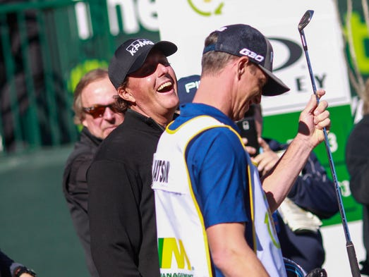 Phil Mickelson shares a laugh before teeing off at