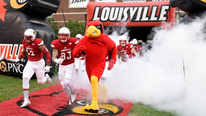 Sep 26, 2015; Louisville, KY, USA; The Louisville Cardinals mascot leads the team before the first quarter against the Samford Bulldogs at Papa John's Cardinal Stadium. Mandatory Credit: Jamie Rhodes-USA TODAY Sports