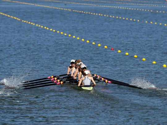 Emily Regan, Kerry Simmonds, Amanda Polk, Lauren Schmetterling, Tessa Gobbo, Meghan Musnicki, Eleanor Logan, Amanda Elmore and Katelin Snyder, of United States, row for gold in the women's rowing eight final during the 2016 Summer Olympics in Rio de Janeiro, Brazil, Saturday, Aug. 13, 2016. (AP Photo/Andre Penner)