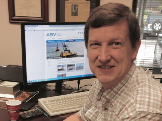 Thomas Chance, now consulting for his former company, C&C Technologies, is pictured at his desk.