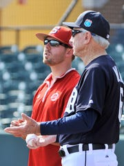Florida Southern assistant coach Colin Kaline talks with his grandfather, Al Kaline, during spring training in Lakeland, Florida.