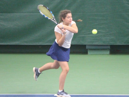 Marie Major of Brookfield Academy chases down a backhand while competing at the state tennis tournament in Madison on Oct. 13.