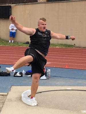 Paxton Titus of Livingston Christian won the shot put with a throw of 55 feet, 9.5 inches in the state Division 4 meet at Grand Rapids' Houseman Field on June 3, 2017.